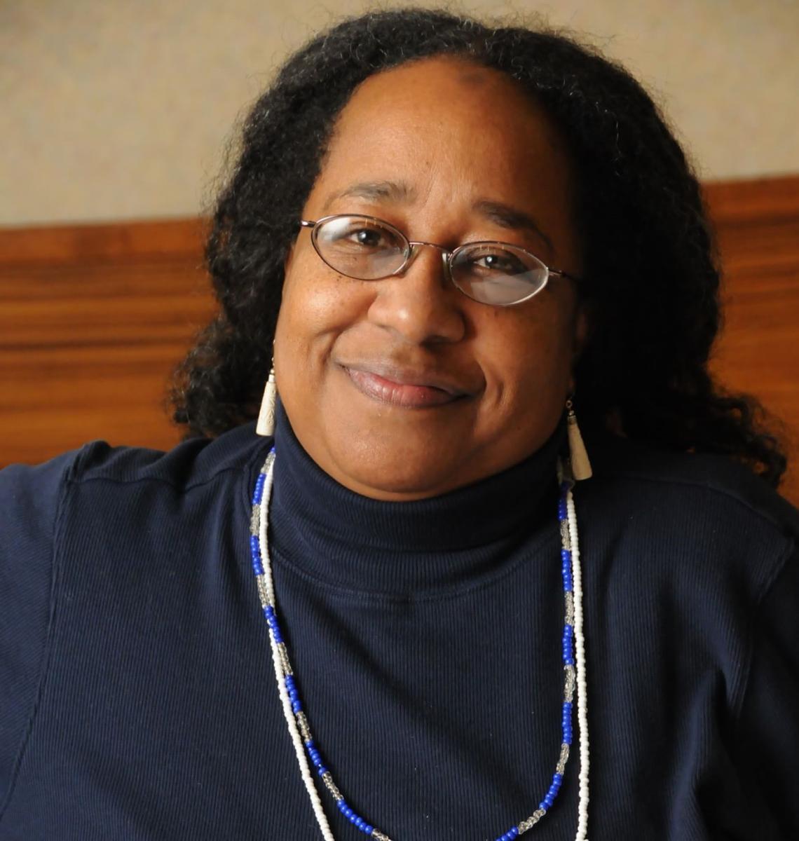 Headshot of EPN Oct 12 speaker Omope Carter Daboiku in a black blouse